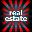 Stock Photo: Real estate word with motion rays on background