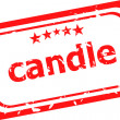 Candle on red rubber stamp over a white background — Stock Photo