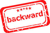 Backward word on red rubber grunge stamp — Stock Photo
