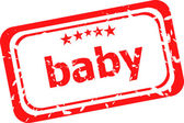 Baby word on red rubber grunge stamp — Stock Photo