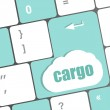Cargo word on laptop computer keyboard key — Stock Photo #35610159
