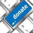 Stock Photo: Donate button on computer keyboard pc key