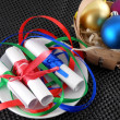 White invitation paper with gift and christmas balls — Foto de Stock