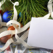 Christmas balls and fir branches with decorations and blank card — Stock Photo