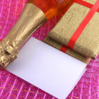 Champagne or wine bottle, blank paper and golden box, New Year or christmas card — Photo
