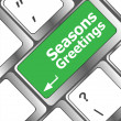 Computer keyboard with seasons greetings keys - holiday concept — Stock Photo