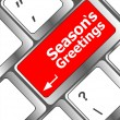 Computer keyboard with seasons greetings keys - holiday concept — Lizenzfreies Foto