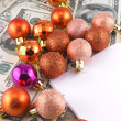 Dollars notes with christmas balls on it — Stock Photo