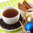 Christmas decoration with cup of coffee, coffee beans and cinnamon — Stock Photo
