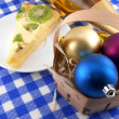 Christmas decoration with christmas balls and sweet kiwi cake — Stock Photo