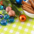Christmas decoration cinnamon baubles stones in yellow macro closeup — Photo