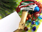 Champagne bottle, diamonds and stones, christmas baubles, Merry Christmas and Happy New Year — Stock Photo