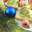 Kiwi cake on plate with christmas balls and new year fir tree — Photo