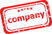 Company on red rubber stamp over a white background — Stock Photo