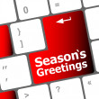 Computer keyboard with seasons greetings keys - holiday concept — Stock Photo #36530833