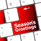 Computer keyboard with seasons greetings keys - holiday concept — Stock Photo