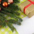 Christmas fir tree with golden gift box and empty paper — Stock Photo