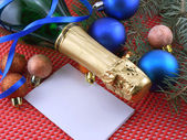 Champagne bottle and christmas decoration, happy new year — Stock Photo