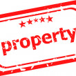 Property on red rubber stamp over a white background — Stock fotografie