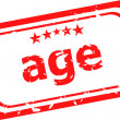 Age on red rubber stamp over a white background — Stock Photo