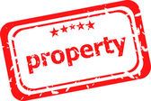 Property on red rubber stamp over a white background — Stock Photo