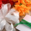 Flowers, christmas balls and white invitation card, christmas decorations — Stok fotoğraf