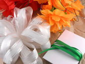 Flowers, christmas balls and white invitation card, christmas decorations — Photo