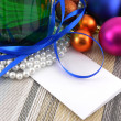 Wine and Pearls, christmas balls set and empty card — Stock Photo