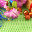 Beautiful flowers, gifts and Christmas balls on green background — Zdjęcie stockowe
