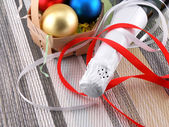 Beautiful ornaments, champagne and balls as a New Year decoration — Stock Photo