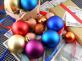 Christmas gift box with christmas balls and money — Stock Photo