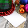 Wine and Pearls, christmas balls set and empty card — Stock Photo #36883041