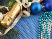 Beautiful ornaments, champagne, pearl and balls as a New Year decoration — Stock Photo