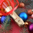 Champagne wine bottle with christmas ball and red ribbon — ストック写真
