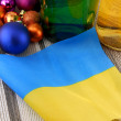Ukraine flag with christmas decoration, new year card — Stock Photo #36932415
