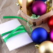 New year and christmas celebration, balls and invitation card — Stock Photo
