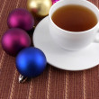 Tea white cup and christmas baubles, holiday concept — Stock Photo