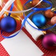 Champagne bottle with christmas ball and blue ribbon, invitation card — ストック写真