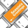 Computer keyboard with seasons greetings keys - holiday concept — Foto de Stock