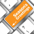 Computer keyboard with seasons greetings keys - holiday concept — ストック写真