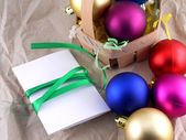 New year and christmas celebration, balls and invitation card — Stok fotoğraf