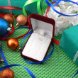 A gift box with a white ribbon and new year balls — Foto de Stock