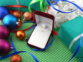A gift box with a white ribbon and new year balls — Foto Stock