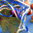 Holiday concept: gifts, pearls, tree branch and christmas ball — Стоковая фотография