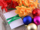 New year and christmas celebration, balls, flowers and invitation card — Stock Photo