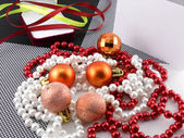Christmas ball and pearls on a plate, new year holiday card — Stock Photo