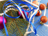 Holiday concept: gifts, pearls, tree branch and christmas ball — Stock Photo