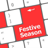 Festive season button on modern internet computer keyboard key — Stock Photo
