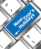 Computer keyboard key with new year holidays words — Stock Photo