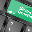Computer keyboard with seasons greetings keys - holiday concept — Stock fotografie